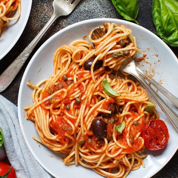 Pasta alla puttanesca - Spaghetti with tomato sauce olives and capers; Shutterstock ID 1372335800; Job (TFH, TOH, RD, BNB, CWM, CM): TOH