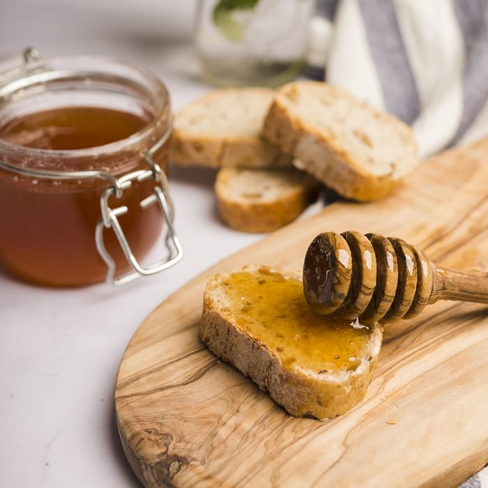 Glass jar full of honey with honey spoon; Shutterstock ID 1426272716; Job (TFH, TOH, RD, BNB, CWM, CM): TOH