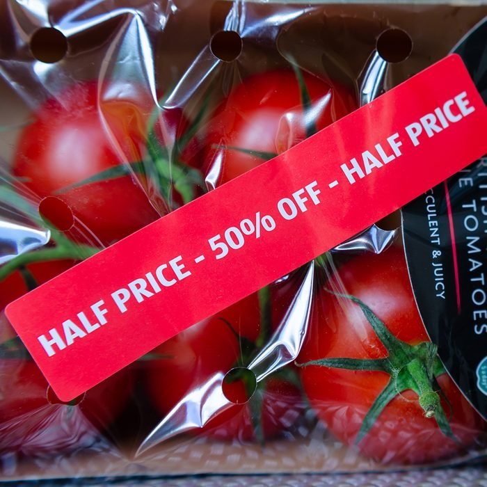 """Stone, Staffordshire / UK - July 1 2019: Pack of British Regal Vine Tomatoes with discount label from ALDI supermarket. Short dated vegetables on clearance are with label: """"Half price, 50% off""""; Shutterstock ID 1439340539; Job (TFH, TOH, RD, BNB, CWM, CM): TOH"""