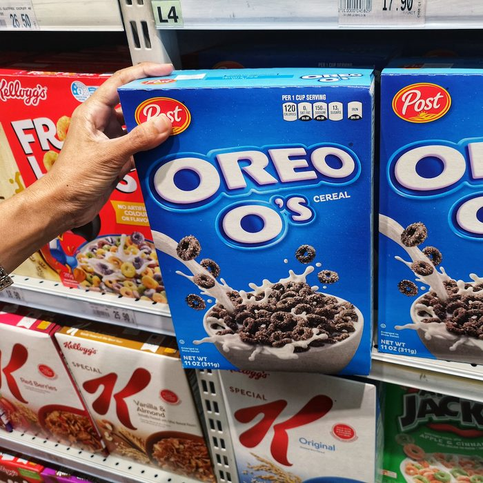 buying a box of OREO O's Cereal in the supermarket aisle