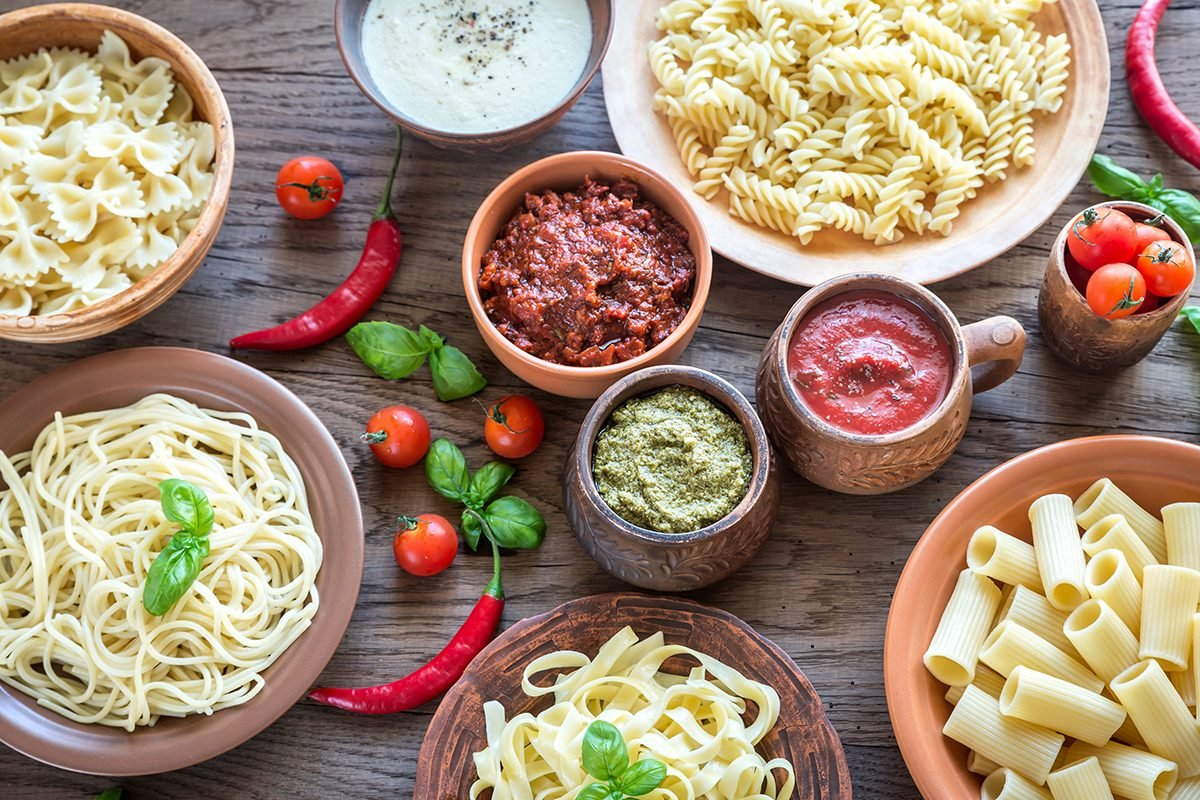 Pasta with different kinds of sauce on the wooden background; Shutterstock ID 437619904; Job (TFH, TOH, RD, BNB, CWM, CM): Taste of Home