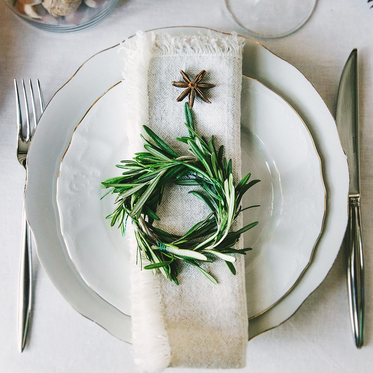 Decorative green wreath on a napkin as a part of table appointment