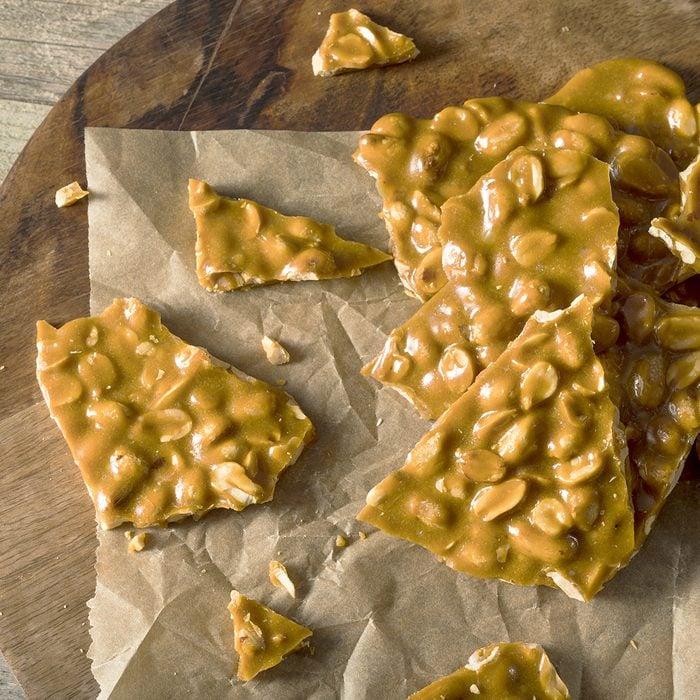 Homemade Holiday Peanut Brittle Broken into Pieces; Shutterstock ID 532125379; Job (TFH, TOH, RD, BNB, CWM, CM): TOH