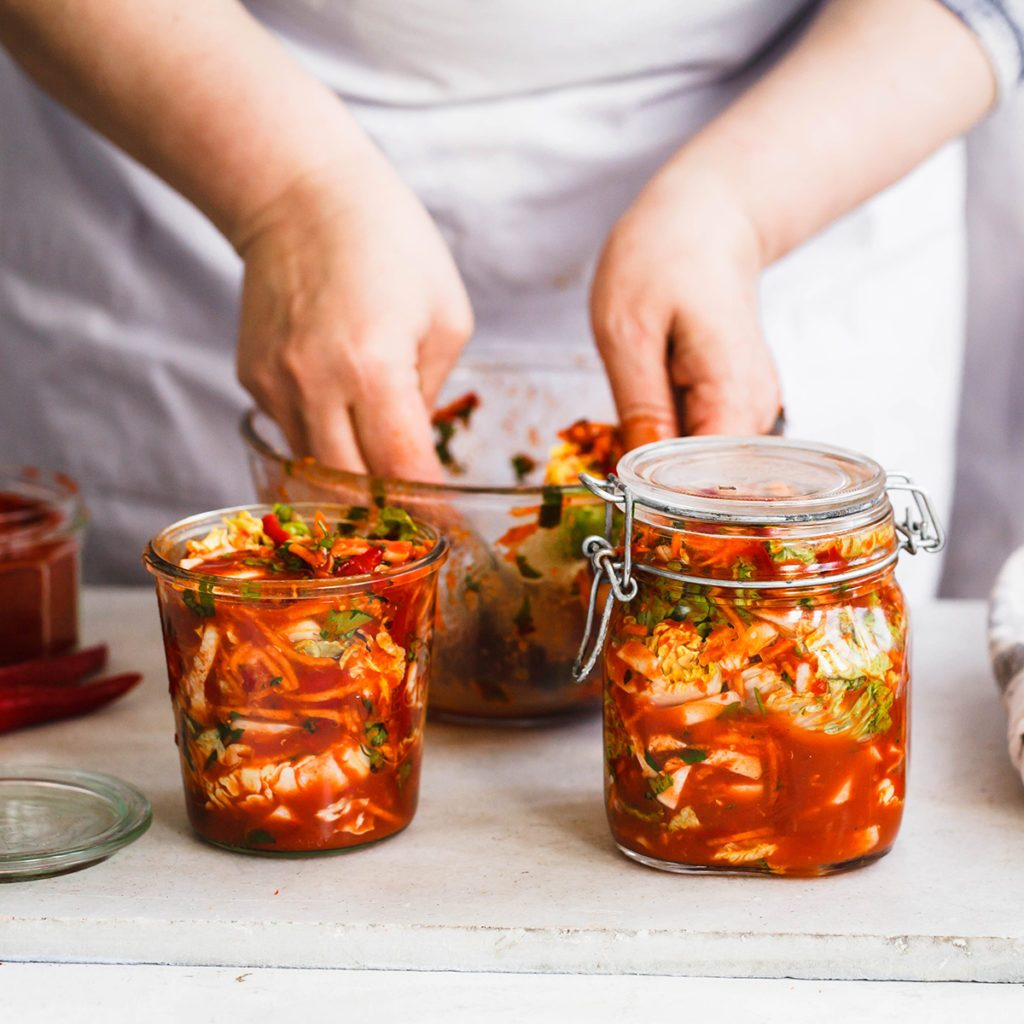 Base Cabbage Kimchi. Person preparing cabbage kimchi. Fermented and vegetarian preserved food concept.; Shutterstock ID 621832271