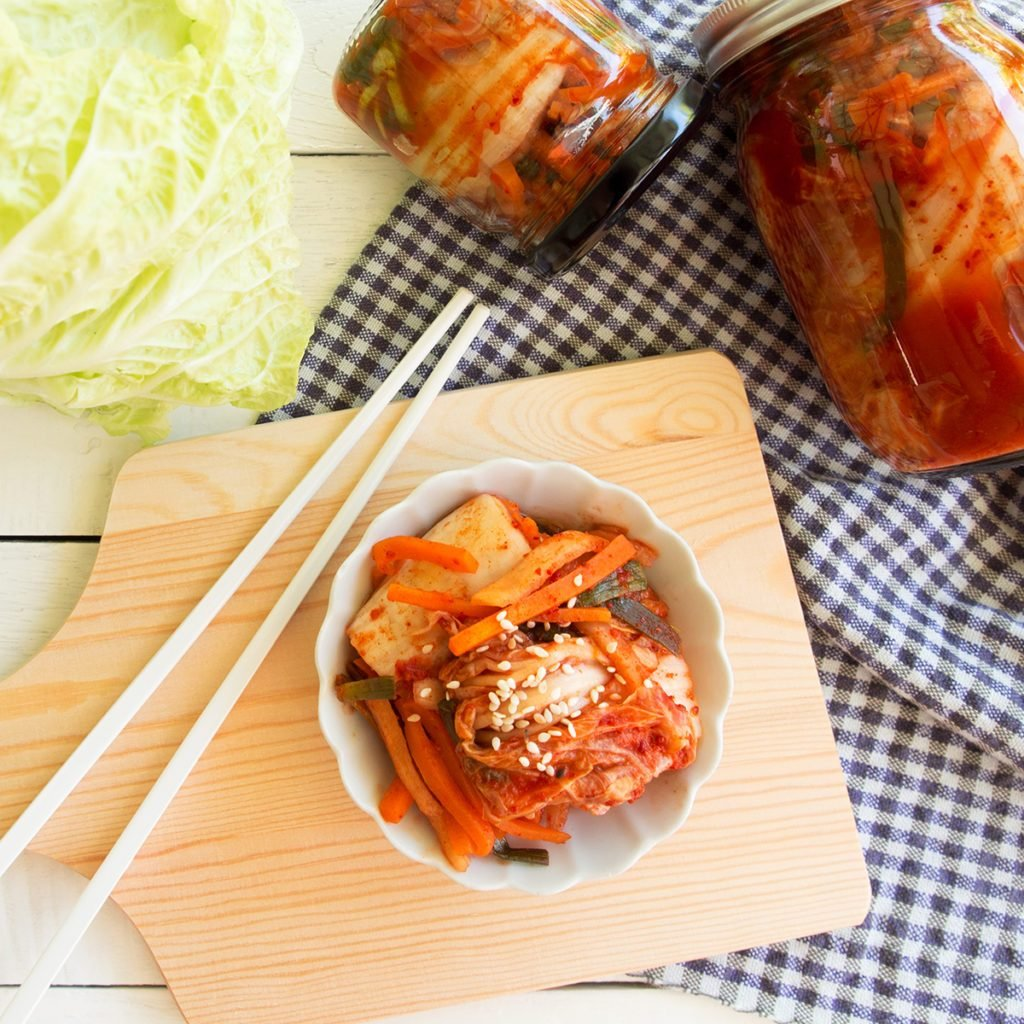 Kimchi,fermented cabbage traditional Korean food in top view on wooden table.; Shutterstock ID 750038686; Job (TFH, TOH, RD, BNB, CWM, CM): Taste of Home