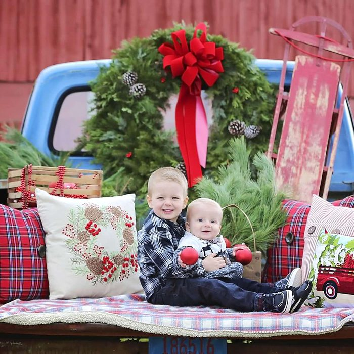 """These brothers; Eli and Evan; love the story about the; """"Little Blue Truck"""". They were so excited to get to sit in the back of the old blue truck parked out in the country and even cooperated for this picture that was taken by their Great Aunt Marianne."""