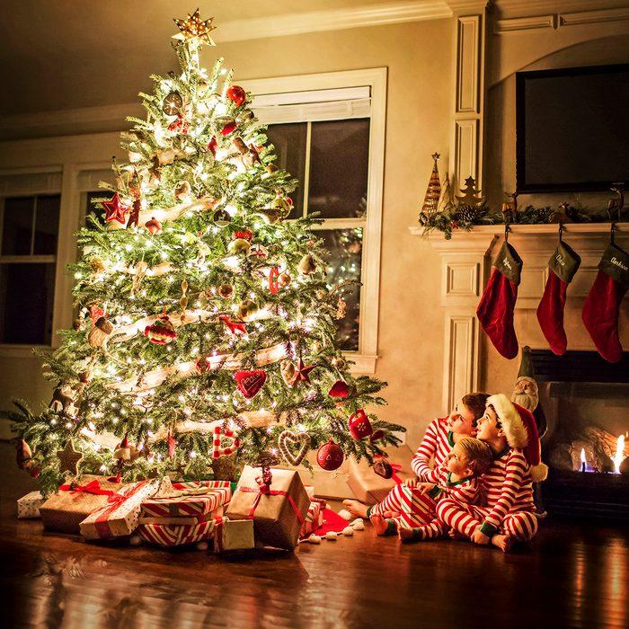 Each year I take a similar photo of my three little boys around the Christmas tree