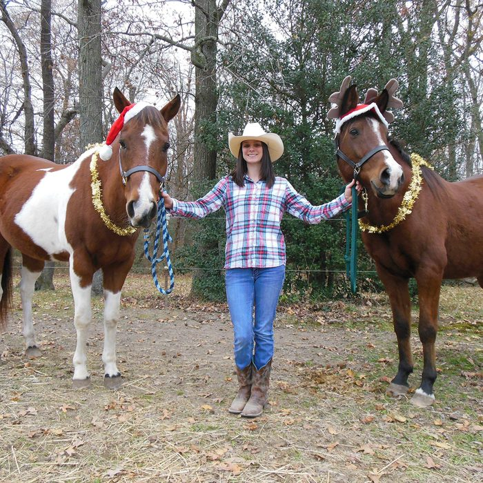 These are my two horses Rascal (the paint) and Palgomej pronounced Pal-go-may (the Arabian) with me in the middle.