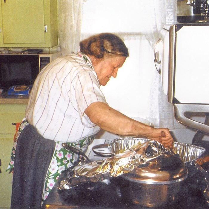 old polish woman prepares thanksgiving dinner