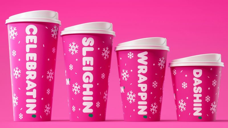 dunkin holiday cups on pink background