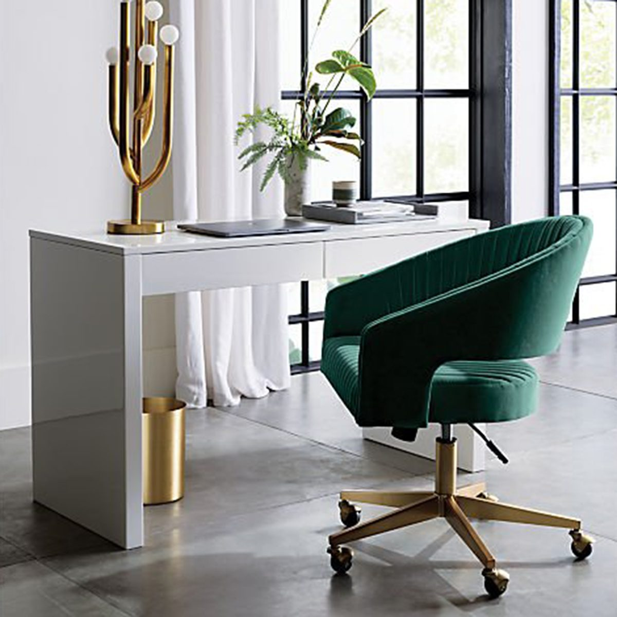 Green chair in a white room with gold accessories