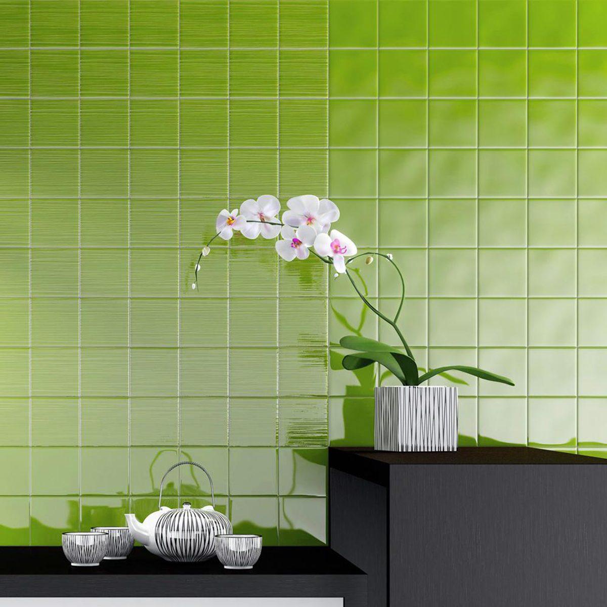 Flowers against green tile