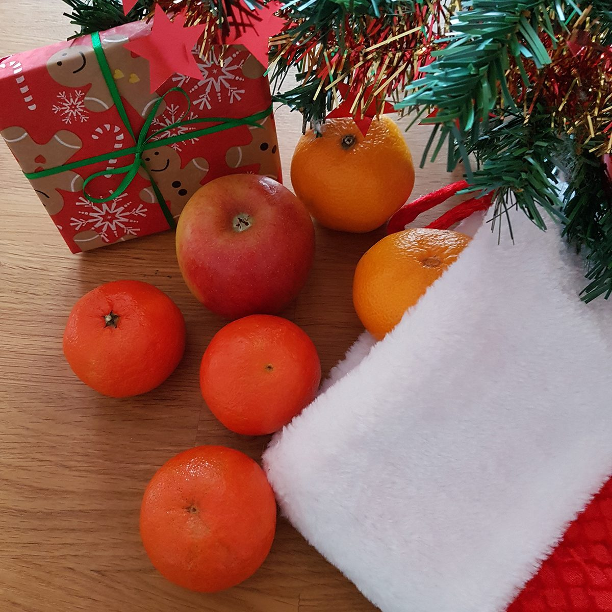 Christmas Stocking filled with fruit and gifts, Christmas decoration