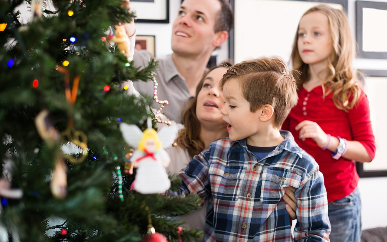 Family of four preparing for Christmas together at home