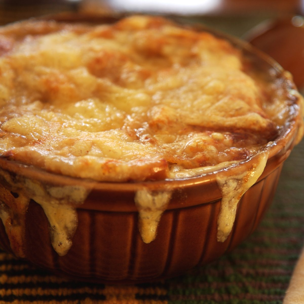 French onion soup, covered with melted cheese