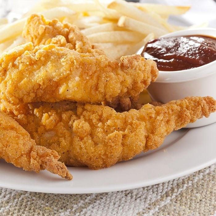Organic Crispy Chicken Strips on a background