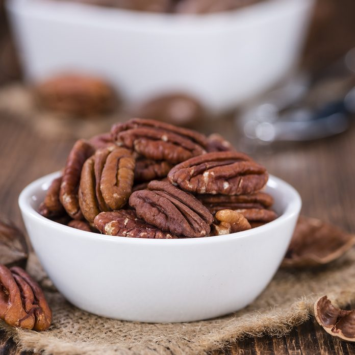 Pecan Nuts (selective focus) on an old vintage wooden table; Shutterstock ID 402069406; Job (TFH, TOH, RD, BNB, CWM, CM): Taste of Home