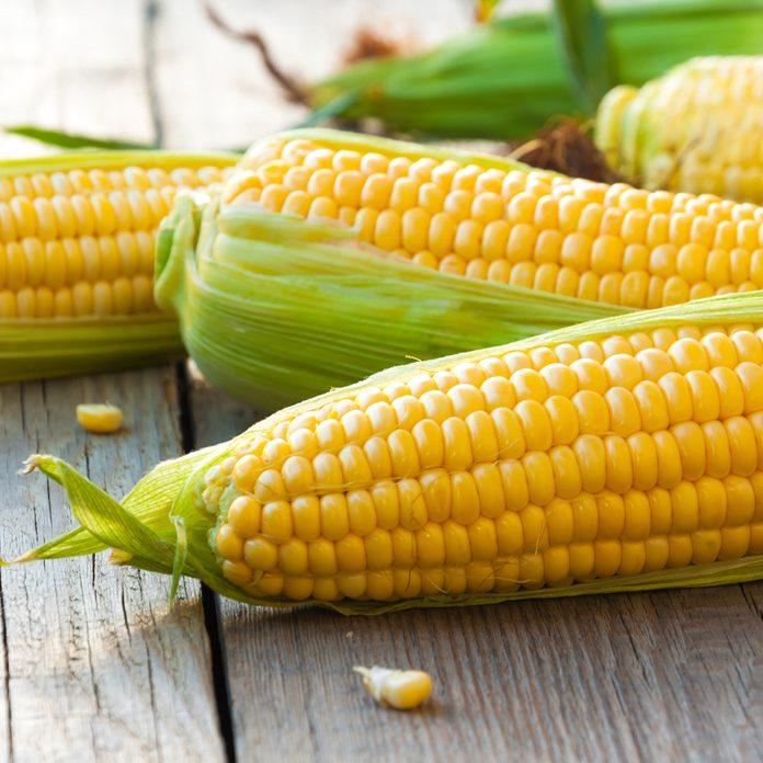 Fresh corn on cobs on wooden table, closeup, top view; Shutterstock ID 473507224; Job (TFH, TOH, RD, BNB, CWM, CM): Taste of Home