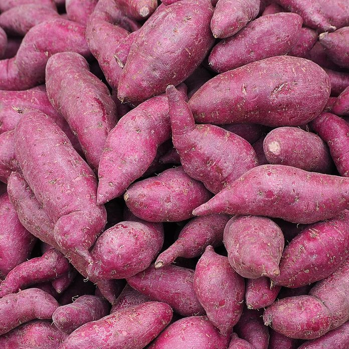 Fresh purple yams pile for sale in fresh market. Fruits organic for good health. Foods and Fruits healthy concept; Shutterstock ID 619062506; Job (TFH, TOH, RD, BNB, CWM, CM): Taste of Home