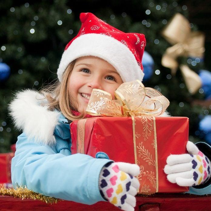 Little girl in Christmas sledge; Shutterstock ID 62389447; Job (TFH, TOH, RD, BNB, CWM, CM): Taste of Home