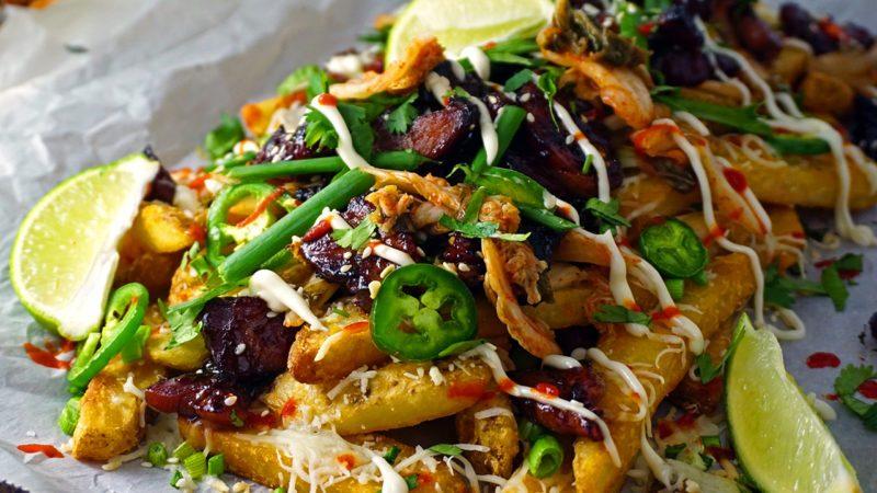 Close-up of kimchi fries at an angle