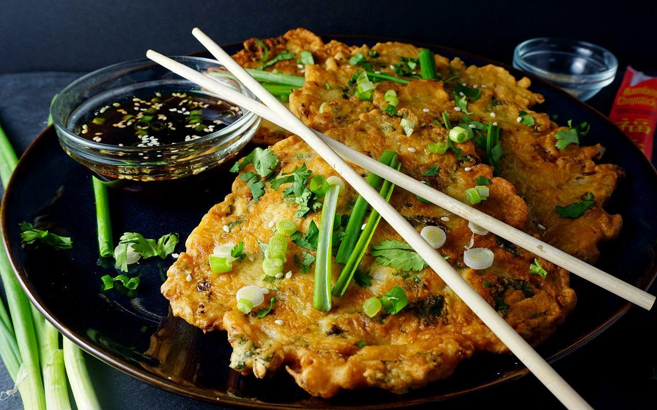 Kimchi pancakes with chopsticks