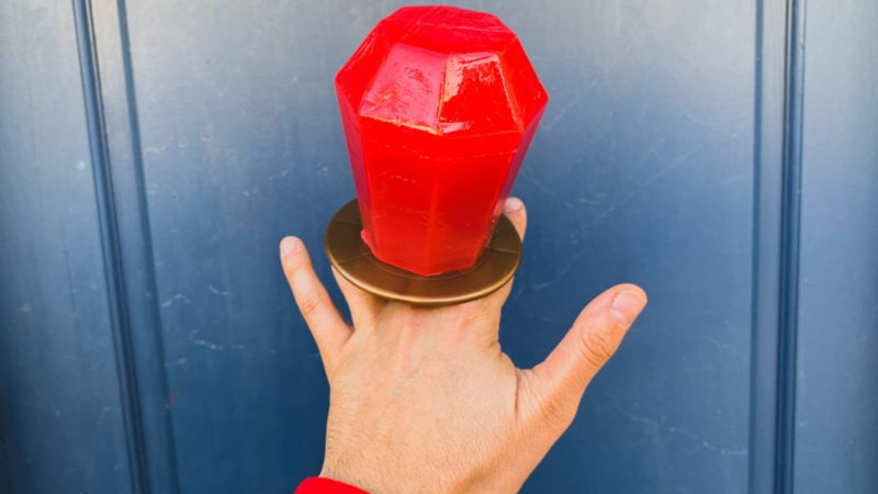 Hand wearing a huge Ring Pop