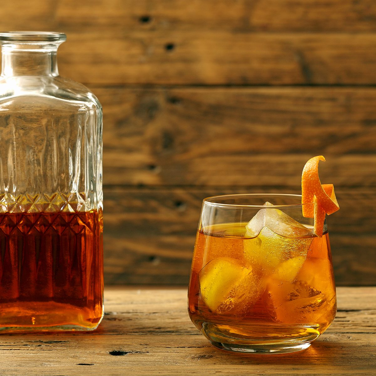 cocktail drink wiskey and orange on rustic background