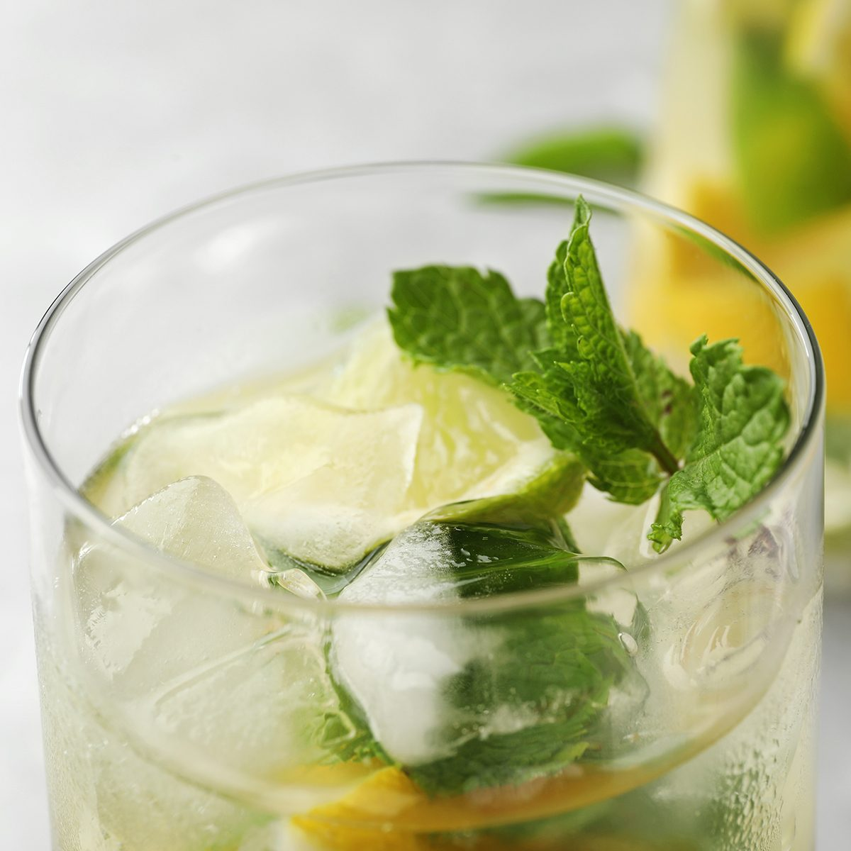 Glass of refreshing lemonade with mint on table, closeup. Summer drink; Shutterstock ID 1441602839; Job (TFH, TOH, RD, BNB, CWM, CM): TOH