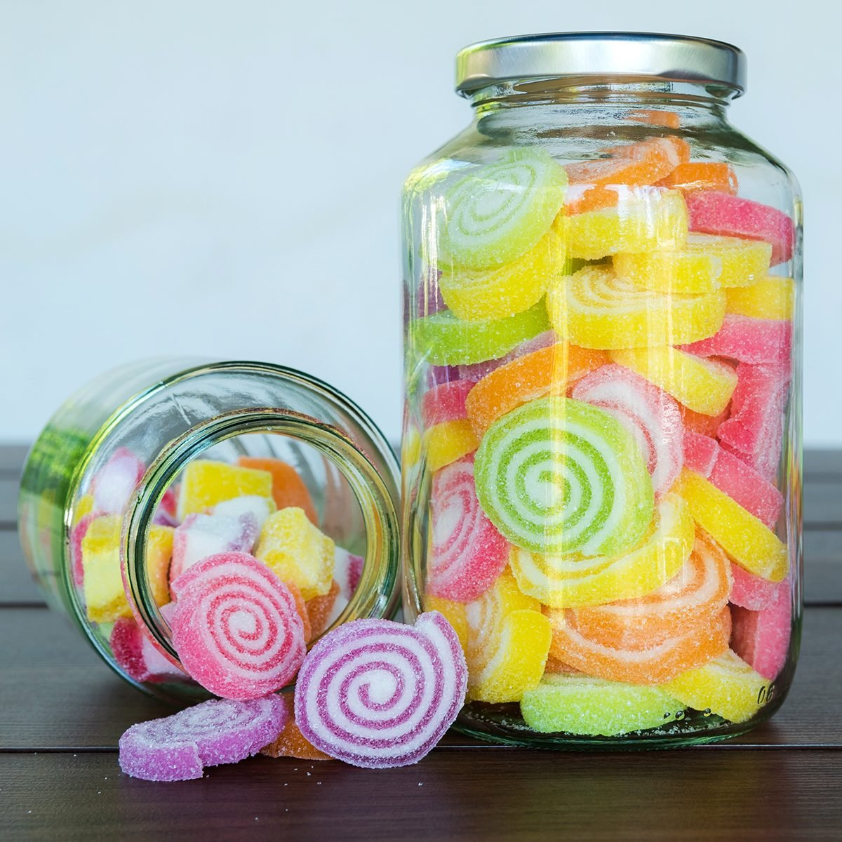 Multi colour candies displayed in glass jars