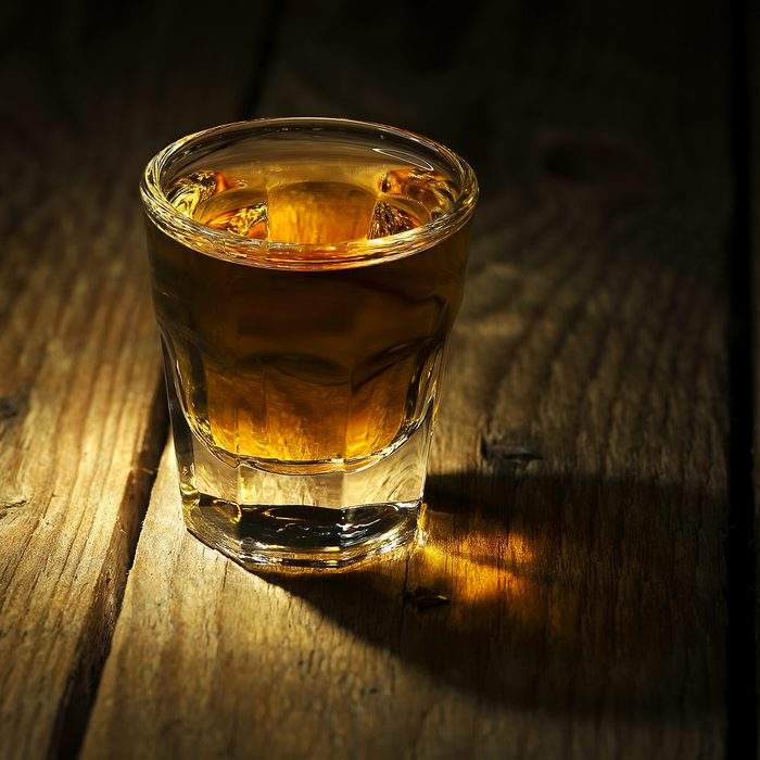 shot of whiskey on old wooden surface