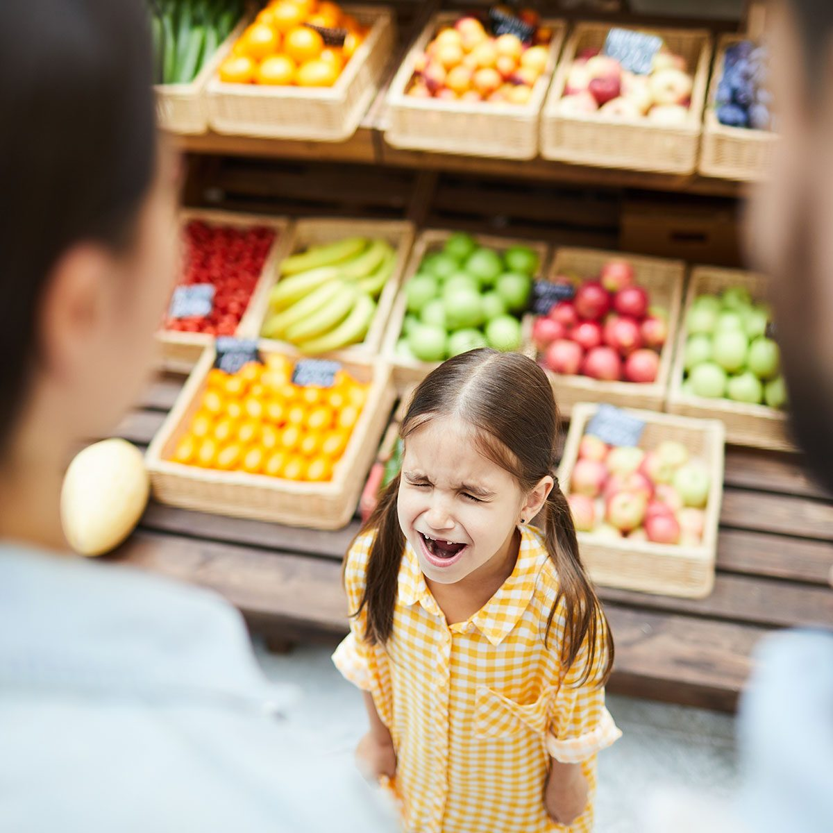 Upset hysterical girl with closed eyes crying loudly while manipulating parents and standing against food stall in supermarket; Shutterstock ID 1220942938; Job (TFH, TOH, RD, BNB, CWM, CM): TOH