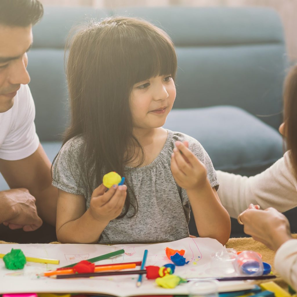 Portrait of happy family daughter girl is learning to use colorful play dough together with parent; Shutterstock ID 1222127461; Job (TFH, TOH, RD, BNB, CWM, CM): TOH