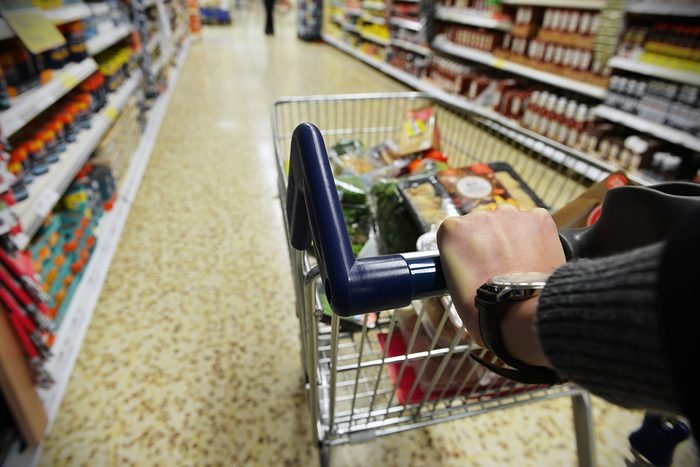 Shopper Pushes a Cart in Supermarket Aisle - Image Has a Shallow Depth of Field; Shutterstock ID 237424663; Job (TFH, TOH, RD, BNB, CWM, CM): Taste of Home