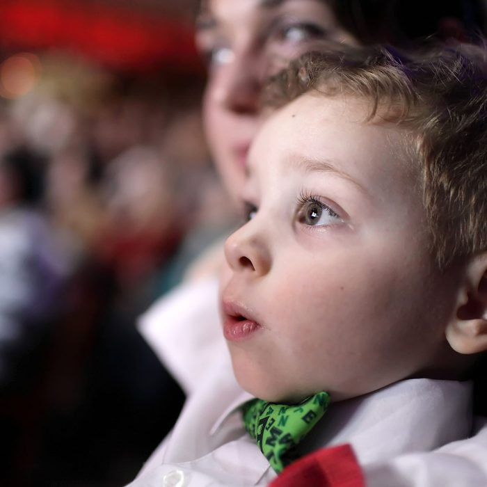 Portrait of astonished child at a circus; Shutterstock ID 512155558