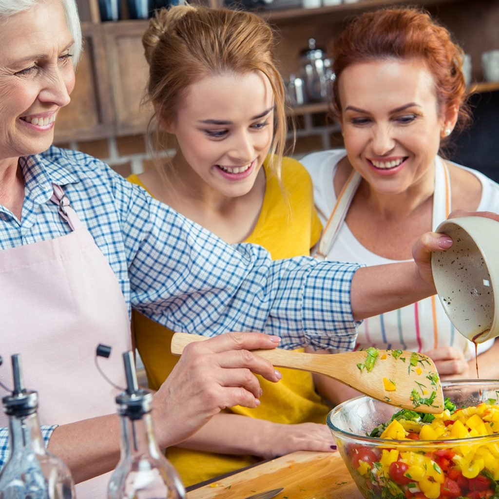 Everything old is new again, 2020 food trends, Happy three-generation family cooking vegetable salad together in kitchen ; Shutterstock ID 549151045; Job (TFH, TOH, RD, BNB, CWM, CM): Taste of Home
