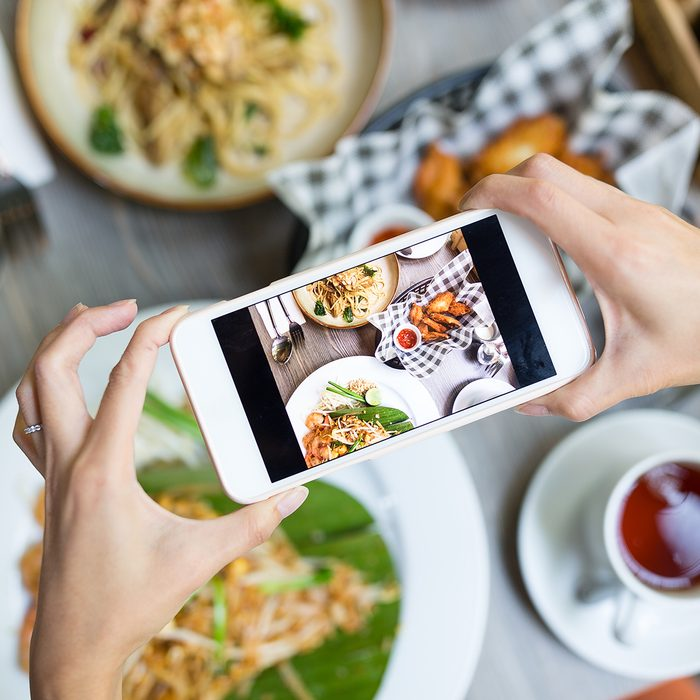doing it for the gram, 2020 food trends, Woman taking photo on cellphone on dish; Shutterstock ID 593589896; Job (TFH, TOH, RD, BNB, CWM, CM): Taste of Home