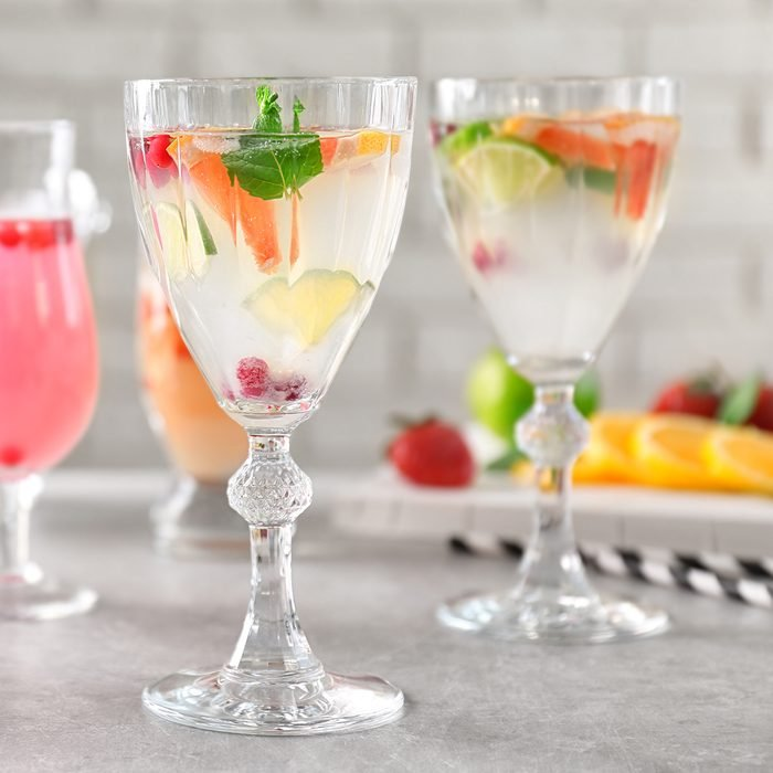 Glasses of delicious wine spritzer on grey table; Shutterstock ID 602851283; Job (TFH, TOH, RD, BNB, CWM, CM): TOH