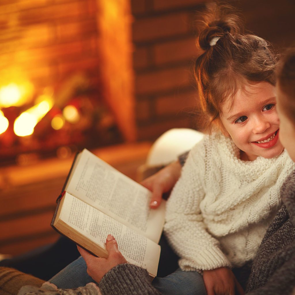 happy family mother and child daughter read a book on winter autumn evening near fireplace ; Shutterstock ID 795241441; Job (TFH, TOH, RD, BNB, CWM, CM): TOH