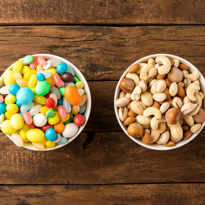 Nuts in one bowl and jellybeans in the other