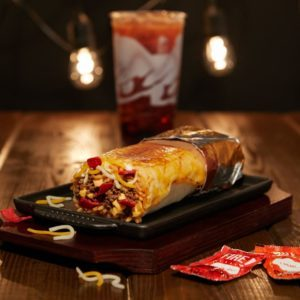 Taco Bell's Newest Burrito Has A Layer Of Cheese Melted On The Outside