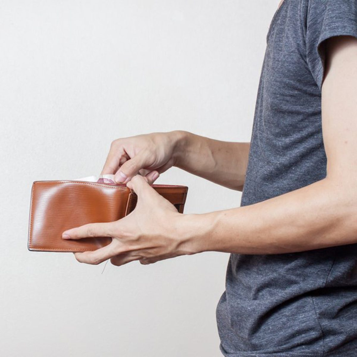 Person looking through their wallet