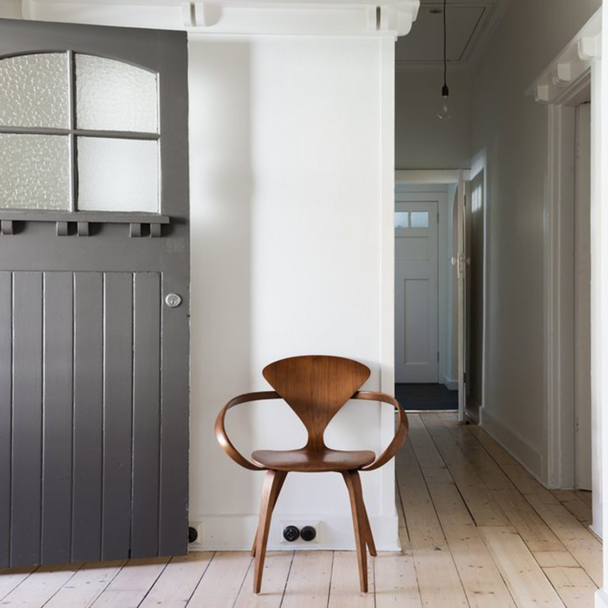 Bare hallway and room with one chair