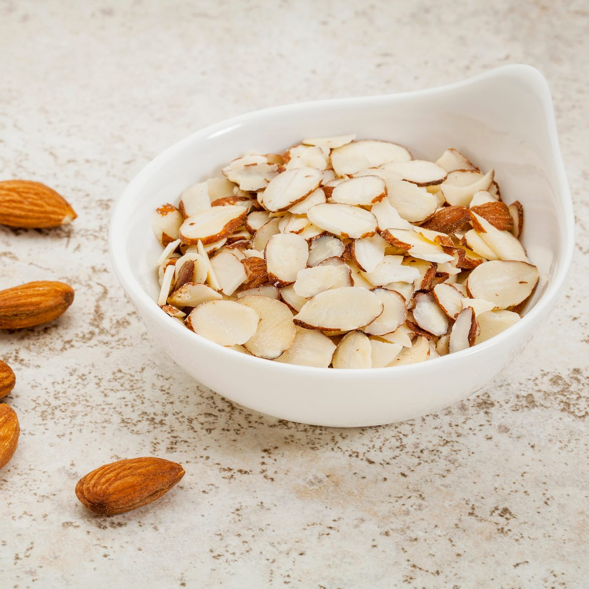 small ceramic bowl of sliced raw almonds