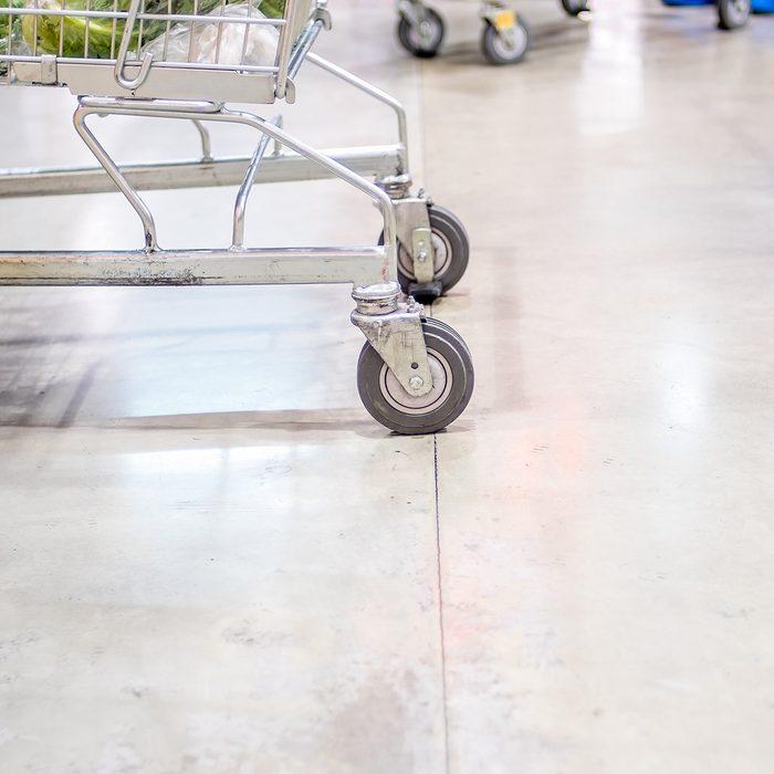Cart wheels rolling along the floor