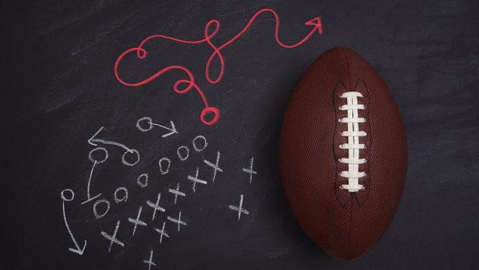 """football and x's on o's on chalkboard. one """"o"""" goes a very different route"""