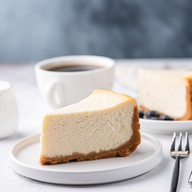 Classical New York Style Cheesecake And Coffee On Table