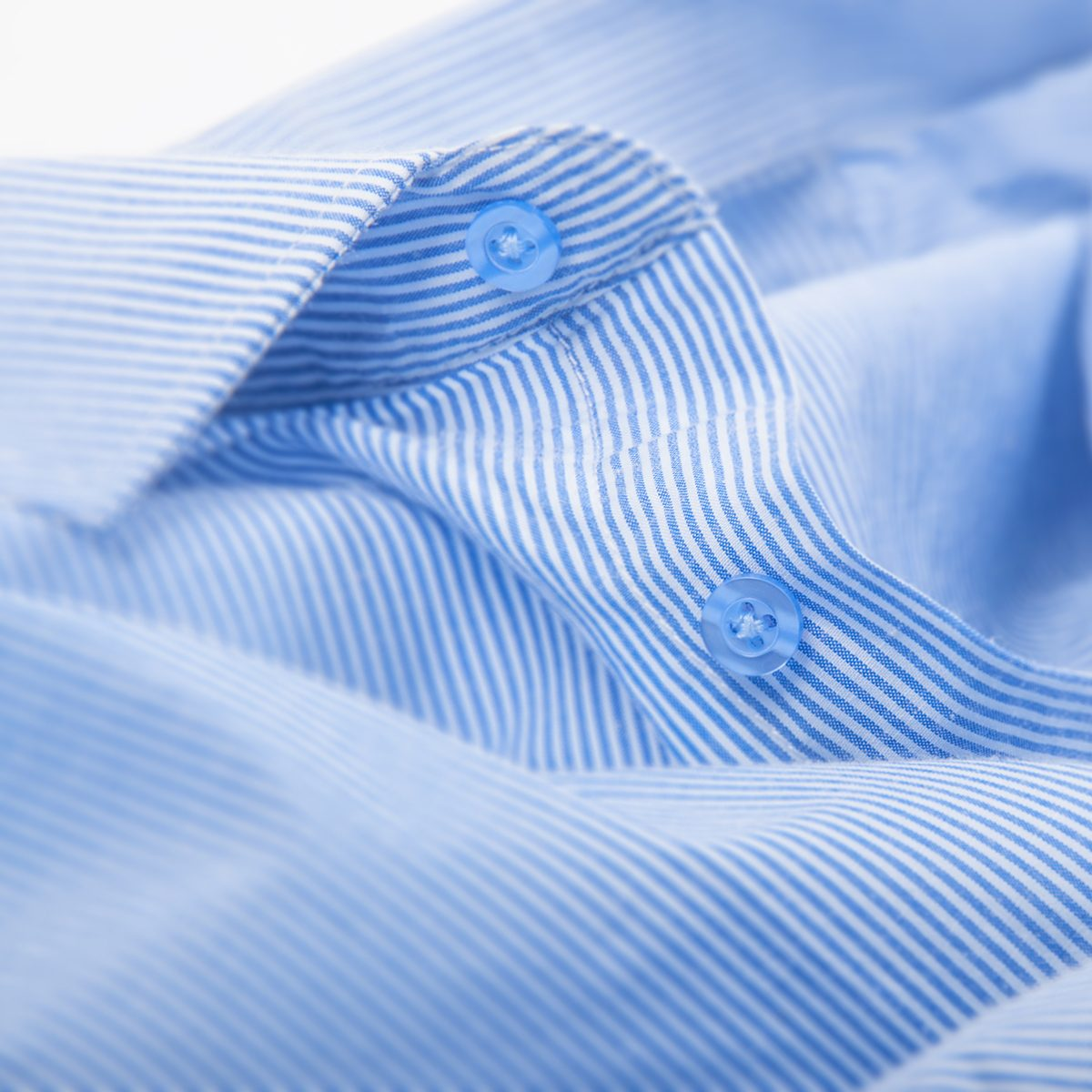 blue striped button down shirt, macro shot