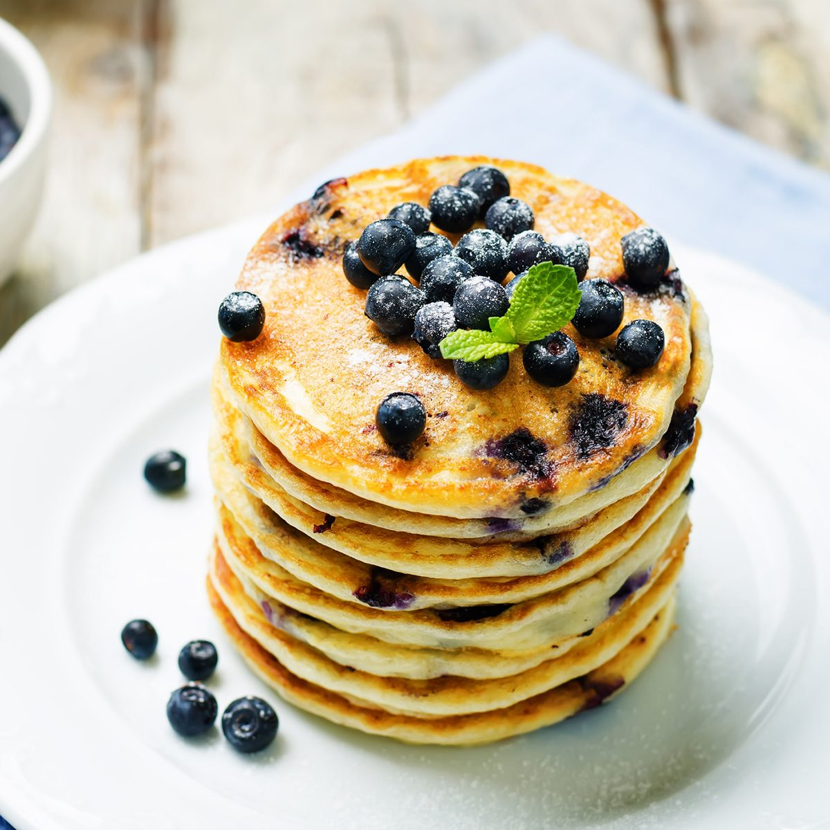 Blueberry Ricotta Pancakes with fresh blueberries and cup of coffee. toning. selective focus