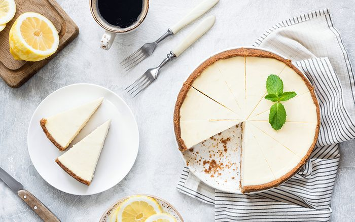 Classical New York Cheesecake On White Background.
